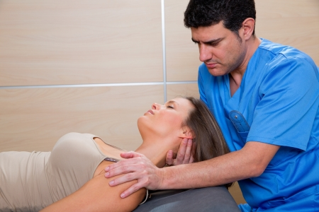 cervical stretching therapy with therapist doctor hands in woman neck Stock Photo - 19637035