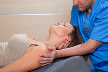 cervical stretching therapy with therapist doctor hands in woman neck Stock Photo - 19637033