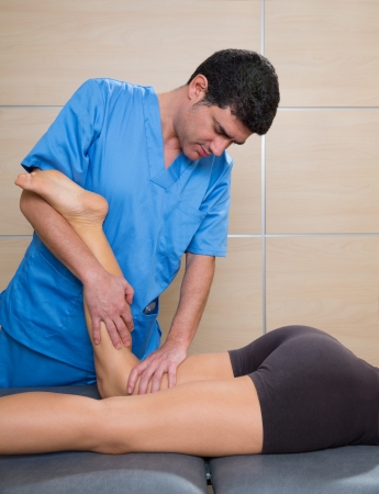 muscle power therapy on woman leg knee by therapist photo