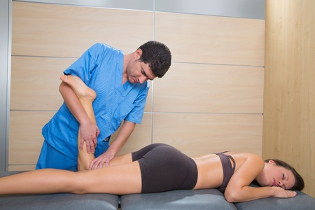 muscle power therapy on woman leg knee by therapist Stock Photo