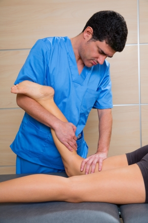 muscle power therapy on woman leg knee by therapist Stock Photo - 19637029