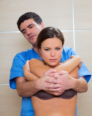 dorsal: Osteopathy dorsal spine manipulation with lift off technic doctor to woman patient