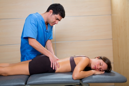 Doctor lumbar exploration on woman patient therapy photo