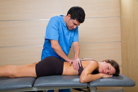 Massage therapy by physiotherapist on back torso to beautiful woman relaxed Stock Photo - 19637009