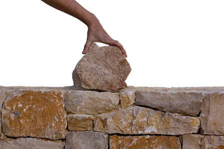 stone work: Mason hands working on masonry stone wall stonewall