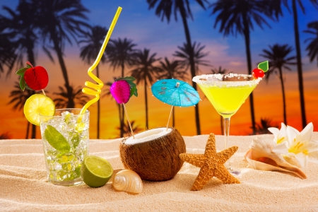 beach cocktail sunset on palm tree sand mojito margarita coconut photo