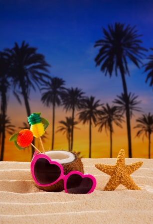 Coconut cocktail on tropical white sand beach heart shape funny sunglasses photo