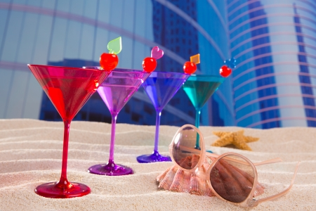 colorful cocktail in a row with cherry sand in urban city building photo