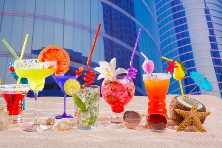 Colorful tropical cocktails in summer at urban city buildings photo
