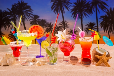 beach tropical cocktails on white sand mojito blue hawaii on sunset palm trees photo