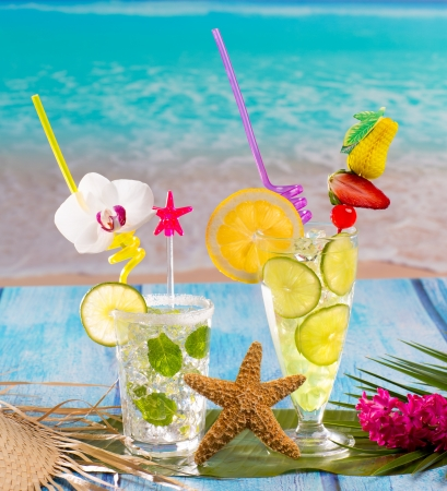 booze: Mojito and lemon lime Cocktails in tropical blue wood at turquoise Caribbean beach