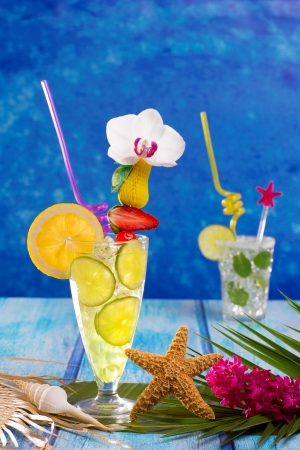 Mojito and lemon lime Cocktails in tropical Caribbean blue wood with starfish flowers and seashells photo