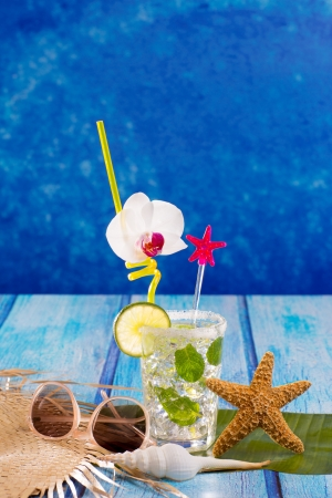 Cubn Mojito cocktail in Caribbean tropical blue wood with starfish and sunglasses photo