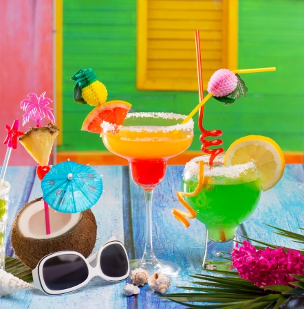 Colorful tropical Cocktails in tropical Caribbean house with coconut pepermint margarita photo