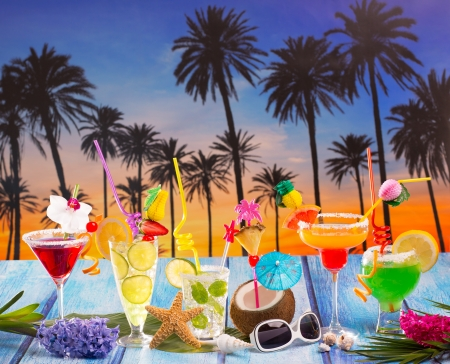 Colorful many tropical Cocktails in tropical blue wood Palm tree sunset with coconut mojito pepermint margarita photo