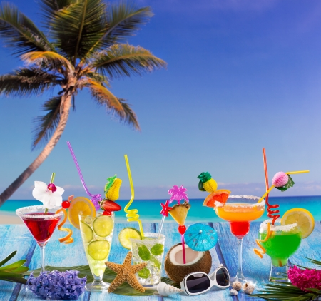hawaii flower: Beach colorful many tropical Cocktails in tropical blue wood with coconut mojito pepermint margarita and palm tree