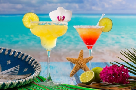 Cocktails Margarita and sex on the beach on blue Caribbean beach with Mexican hat photo