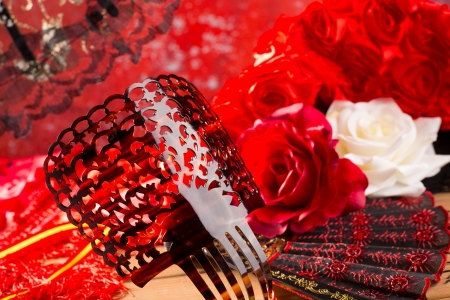 comb: Flamenco comb fan and roses typical from Spain Espana on red background Stock Photo