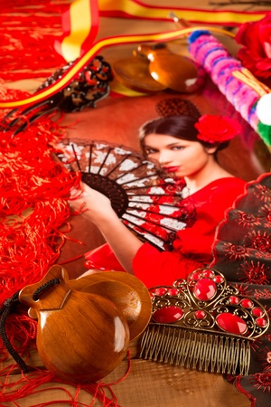 Flamenco woman with bullfighter and typical Spain Espana elements like castanets fan and comb photo