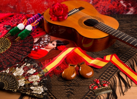 spanish girl: Classic spanish guitar with flamenco elements as comb fan and castanets