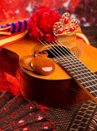 spanish dancer: Classic spanish guitar with flamenco elements as comb fan and castanets