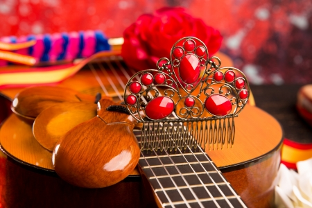 spanish dancer: Classic spanish guitar with flamenco elements as comb and castanets
