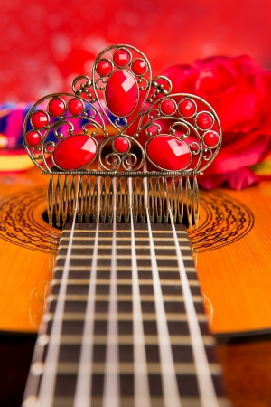 Classic spanish guitar with flamenco elements as dancer comb photo