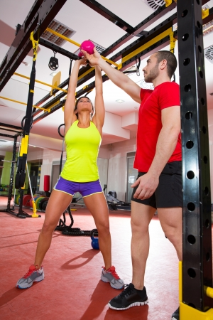 crossfit: Crossfit fitness Kettlebells swing exercise man personal trainer at gym