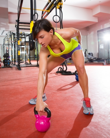 fit: Crossfit fitness Kettlebells swing exercise woman workout at gym
