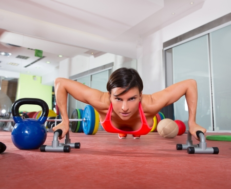 gripping bars: Crossfit fitness woman push ups with pushup bars grips exercise