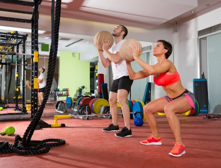 gym ball: Crossfit ball fitness workout group woman and man at gym