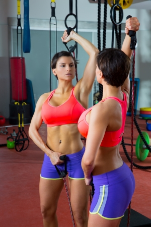 mirror: Crossfit fitness jumprope woman looking at mirror with jump rope workout