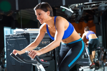 Aerobics spinning monitor trainer woman at gym at trainning class photo