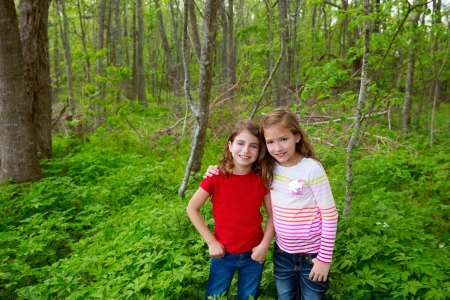 children sister friends playing relaxed on the jungle park forest outdoor photo