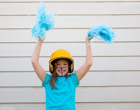 pom pom: baseball cheerleading pom poms girl happy smiling with yellow helmet
