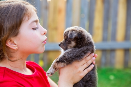 Beautiful kid girl portrait with puppy chihuahua gray dog photo