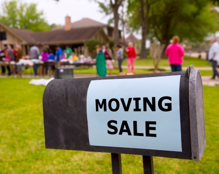 clutter: Moving sale in an american weekend on the yard green lawn