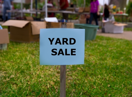 garage background: Yard sale in an american weekend on the green lawn