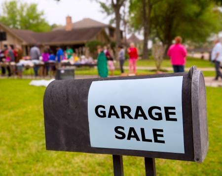 yard sale: Garage sale in an american weekend on the yard green lawn Stock Photo