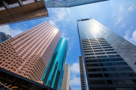 rise and shine: Houston downtown skyscrapers disctict with mirror blue sky reflection Editorial
