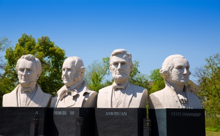 busts: busts of four statesmen carved statues on Houston I-45