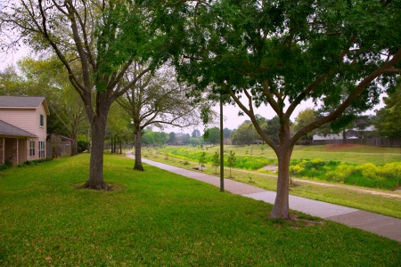 Creek park with track and green lawn grass in Texas outdoor