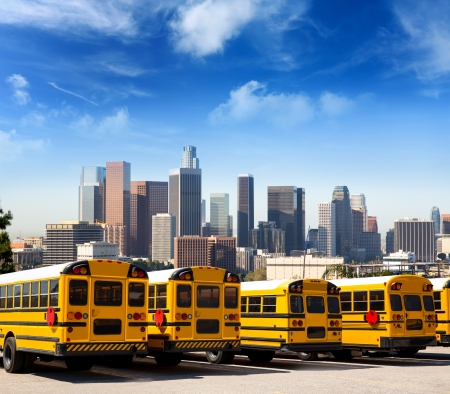American typical school bus rear view in a row at LA skyline photo mount