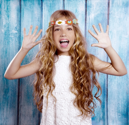 Hippie children girl excited open mouth with open hands and raised arms photo