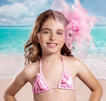 Children girl in tropical turquoise beach vacations with pink fashion style vintage color