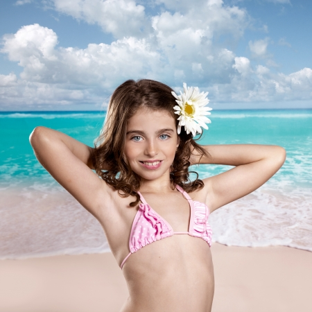 Brunette girl in tropical beach with daisy flower happy for vacation vintage color photo