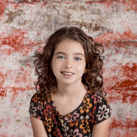 Bunette kid girl portrait smiling in retro vintage color photo