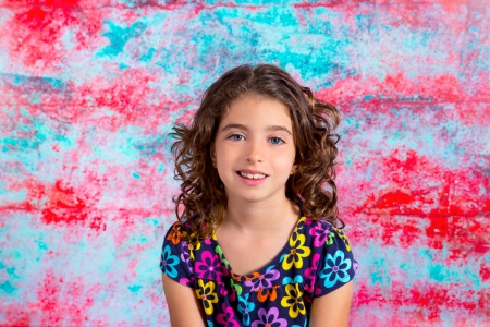 Bunette kid girl portrait smiling in grunge red green background photo