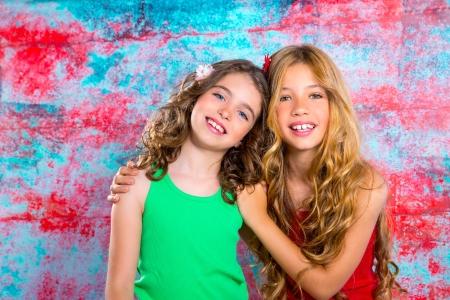 friends beautiful children girls hug together happy smiling on grunge background photo
