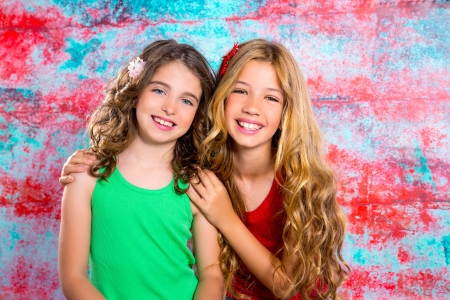 friends beautiful children girls hug together happy smiling on grunge background photo